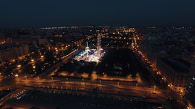 Aerial shot of night Valencia with amusement park. Aerial view of night illuminated Valencia with car traffic on the roads and luminous amusement park in green stock video footage