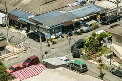 Aerial shot of a normal day in a Malaysian suburb at a crossroad. In a sunny day Stock Photos