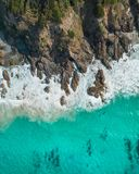 Aerial shot of the ocean and rocky cliffs. Drone nature shot royalty free stock images