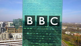 Aerial shot of office skyscraper with British Broadcasting Corporation BBC logo. Modern office building. Editorial 3D. Aerial shot of office skyscraper with vector illustration