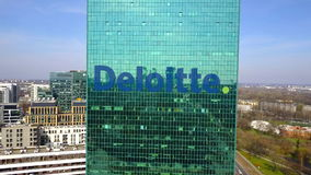 Aerial shot of office skyscraper with Deloitte logo. Modern office building. Editorial 3D rendering 4K clip stock video footage