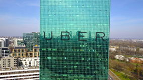 Aerial shot of office skyscraper with Uber Technologies Inc. logo. Modern office building. Editorial 3D rendering 4K. Aerial shot of office skyscraper with Uber stock video footage