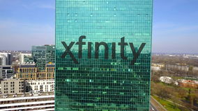 Aerial shot of office skyscraper with Xfinity logo. Modern office building. Editorial 3D rendering 4K clip