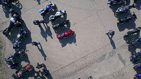 Aerial shot of outdoor motorcycle show, low altitude top view Royalty Free Stock Image