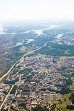 Aerial shot over IT center Kista Stockholm. STOCKHOLM, SWEDEN - JUNE 1, 2018: Aerial shot over IT center Kista Stockholm during inflight to Arlanda airport on a stock photos