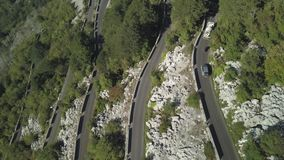 Aerial shot over famous serpentine mountain road. Stock. Serpentines road with traffic on the side of the mountain cliff stock video