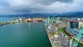 Aerial shot over the industrial sea port in Batumi stock video footage
