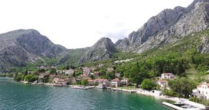 Oyster farming in Montenegro. Aerial shot of oyster and mussel farming with traps and buoys in Boka-Kotor bay, Montenegro, the Adriatic coast in the springtime stock video footage