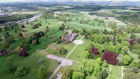 Aerial shot of a park in forest landscape castle Scotland Great Britain. Aerial shot of a park in a forest landscape castle Scotland Great Britain stock footage
