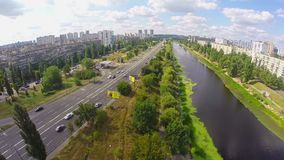 Aerial shot of peaceful city road, river and magnificent sky. Stock footage stock footage