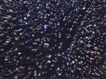 An aerial shot of the people gathered for an event. Crowed open-air meeting of people shot from a height. A mass of people gathere stock photo