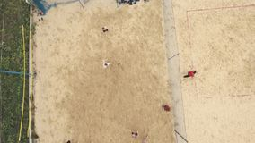 Aerial shot people playing beach football on two fields covered with sand stock video