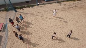 Aerial shot people playing beach petanque at sand playground on sunny day stock video