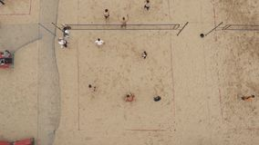 Aerial shot people playing beach volleyall on two fields covered with sand stock video footage