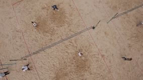 Aerial shot people playing beach volleyball and badminton at sand playground stock video
