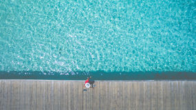 Aerial Shot Photography of Woman Sitting Beside Pool Royalty Free Stock Photo