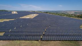 Aerial shot of photovoltaic solar farm. Solar farm power station from above. Ecological renewable energy. Stock Images