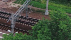 Top view of empty railway with multiple tracks and platform on summer day stock video footage