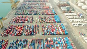 Aerial shot of big port container yard, tilt-shift shallow focus effect. Export, import, logistics concept. Aerial shot of port container yard, tilt-shift Royalty Free Stock Photo