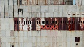 AERIAL SHOT Post Apocalyptic background from ferroconcrete wall Row of panels with rusty spots With around hat on the
