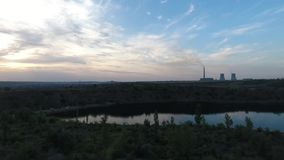 Aerial shot of power plant on sunrise stock footage
