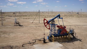 Aerial Shot Of A Pump Jack In The Sand Desert 60fps stock footage