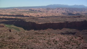 Aerial shot of red rock cliffs and colorado river. Video of aerial shot of red rock cliffs and colorado river stock video footage