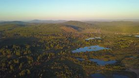 Aerial shot rising over the treetops revealing the Appalachian Mountain Range on a bright day. Aerial shot rising over the treetops revealing the Appalachian stock video footage