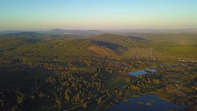 Aerial shot rising over the treetops revealing the Appalachian Mountain Range on a bright day. Aerial shot rising over the treetops revealing the Appalachian stock video