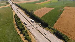 Aerial road highway countryside car auto. Aerial shot on the road in beautiful countryside in the summer stock video footage