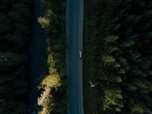 Aerial shot of road in valley while sunset behind mountain Royalty Free Stock Photography