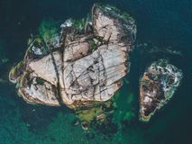 Aerial shot of a rocky island in an ocean royalty free stock image