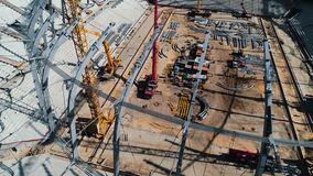 Aerial shot of roof of a football stadium construction stock footage
