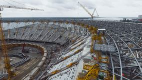 Aerial shot of roof and seats of a football stadium construction stock video