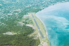 Aerial shot The runway. Taxiway, terminal, and aircraft parking at small city airport Stock Images