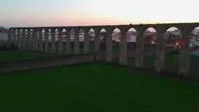 Aerial shot Santa Clara Aqueduct, flying backwards, in Vila do Conde, Portugal. Aerial shot pulling away from ancient Santa Clara Aqueduct, built in 17th century stock video