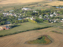 Aerial shot of saskatchewan. City and farmland after autumn harvest Royalty Free Stock Photography