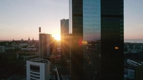 Aerial Shot of Scene with Modern Buildings in the City at the Sunset stock footage