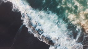 Aerial shot. Sea waves beating against the shore. Surf aqua. Storm on the beach.  stock footage