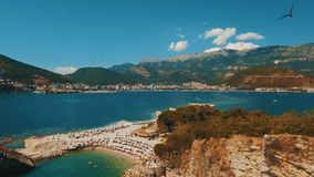 Aerial shot of sea waves and cliff. Sveti Nikola Island rock coast drone footage. 4K UHD stock video footage