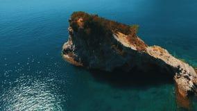 Aerial shot of sea waves and cliff. Sveti Nikola Island rock coast drone footage. 4K UHD stock video