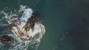 Aerial shot of the sea waves washing rocks in black sea. View from above. Aerial view of the sea waves washing rocks in black sea stock video footage