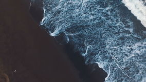 Aerial shot Sinii waves beating against the shore. Surf aqua. Storm on the ocean. View from above. stock video