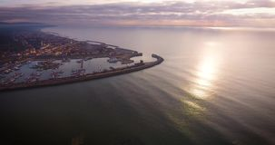Aerial shot of small port in the winter sunset in Pisa Tuscany Italy filmed with drone stock footage
