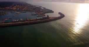 Aerial shot of small port in the winter sunset in Pisa Tuscany Italy filmed with drone stock video footage