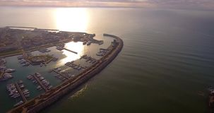 Aerial shot of small port in the winter sunset in Pisa Tuscany Italy filmed with drone stock video