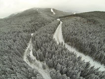 Aerial shot of snow-covered road in the countryside Carpathian Mountains Stock Photo
