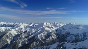 Aerial shot of snowy mountain peak. Aerial shot of snowy mountain peak stock video