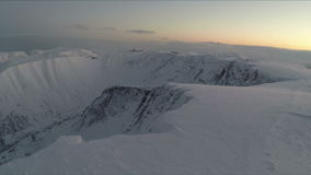 Aerial shot of snowy mountains in the north stock video footage