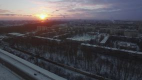 Aerial view of winter St. Petersburg at sunrise, Russia. Aerial shot of snowy Saint Petersburg at dawn, Russia. Winter scene with typical apartment blocks, roads stock video footage